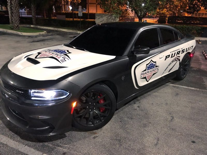 @miamiexoticautoracing x @darkhorsemiami Pursuit car partial wrap on this Hellcat. Check it out at @miamiexoticautoracing Miami's Vehicle Wrap Specialist – Call Us Today!! @tr3performance !!!! . . . . . . . . . . . . #carlifestyle #hellcat #hellcatcharger #charger #cars #sportscar #musclecars #carsofinstagram #pursuit #miami #miamiexoticautoracing #modcar #srt #dodge #racing #performancecar #wrap #vinyl #carwrap #redwhiteandblue #police #customcars #carenthusiast #design #graphicdesign #print #chargerfam #carlovers #rims #miamilife